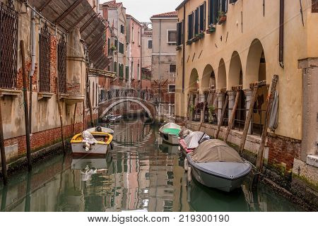 Typical view of the narrow side of the canal, Venice, Italy. Communication in the city is done by water, which creates a network of 150 channels interconnected. Nobody here. Photo from the water level.