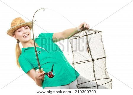 Fishery spinning equipment angling sport and activity concept. Woman with fishing rod and net.