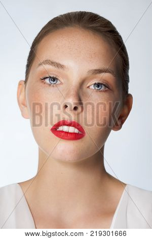 Natural Young Woman With Freckles