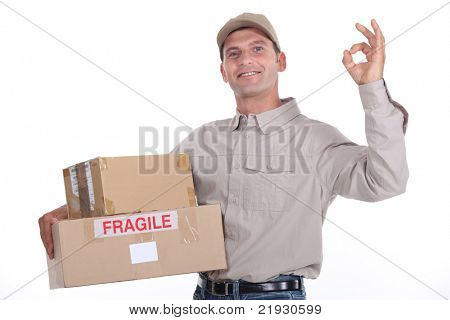 delivery man holding packages and doing the okay sign