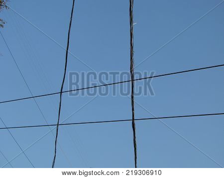 wires pole with blue sky. electrical wires on a background. electric cables. power cable with blue sky. Transmission Line cables. Electric wire in the sky backdrop. Electric wire isolated background.