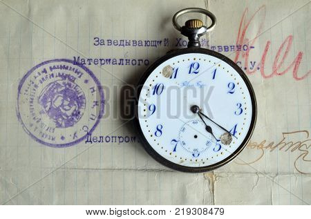 ILLUSTRATIVE EDITORIAL.Soviet vintage watch and Railway Soviet document circa 1919.Kiev,Ukraine December 21 ,2017