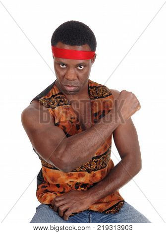 A handsome African American man sitting in a vest making a fist and looking angry isolated for white background