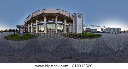GRODNO BELARUS - APRIL 20 2016: Panorama near modern railway station with mirrored walls in evening. Full 360 by 180 degree seamless spherical panorama in equirectangular equidistant projection.