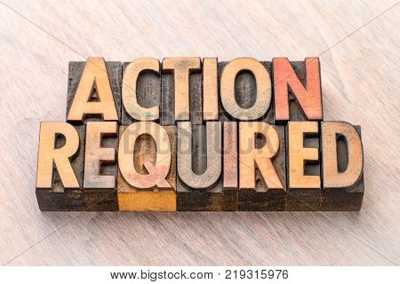 Action required - word abstract in vintage letterpress wood type
