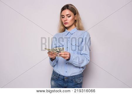 Business woman counting money. Financial freedom target success concept. Girl calculating salary