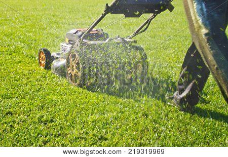 Mowing grass in a football stadium spring summer