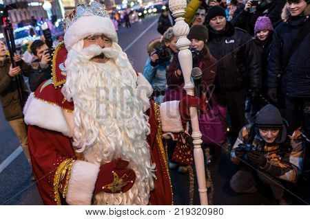 St. Petersburg Russia - December 22 2013: Santa Claus congratulates children on the coming New Year. Jokes and fun on the city's main street in the evening
