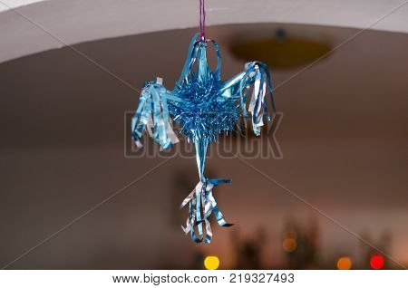 Blue pinata as decoration for Christmas and New Year on blurry background