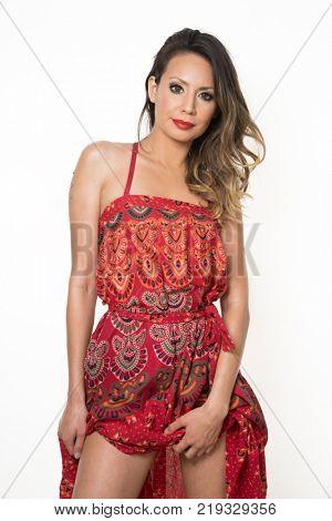 Beautiful latina wearing red dress