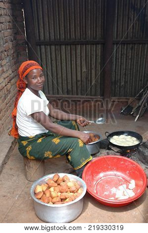 20 August 2017-Pomerini Village in Tanzania-Africa-An unidentified African woman preparing fried bread in the Pomerini Community run by the Franciscan Friars