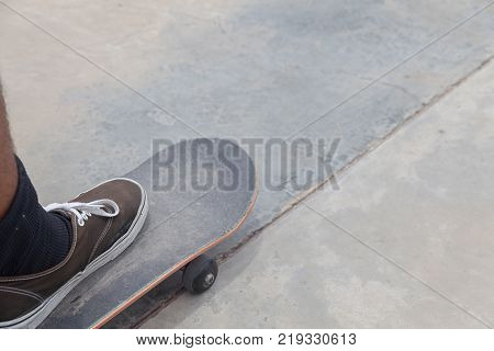 outdoor shoe and skateboard on concrete ramp