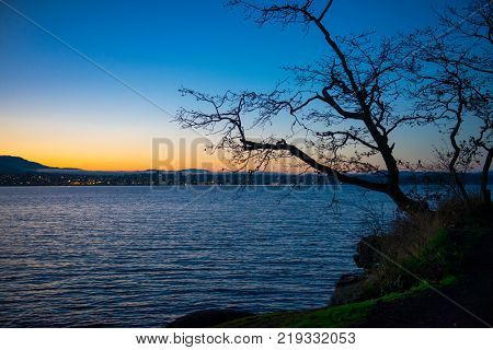 View of Nanaimo bay and skyline at dusk, taken from  Jack Point and Biggs Park in Nanaimo, British Columbia.