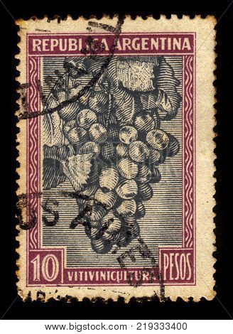 ARGENTINA - CIRCA 1936: a stamp printed in the Argentina shows bunch of red grapes, series country products, circa 1936