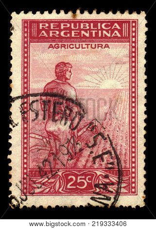ARGENTINA - CIRCA 1936: a stamp printed in the Argentina shows farmer meets the dawn on the field, series country products, circa 1936
