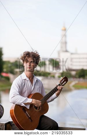 Guitar romantic man city musician concept. Playing stringed instruments lessons. Lifestyle of talented people.