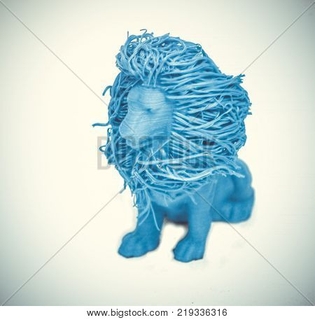 Objects printed by 3d printer Isolated on white background. Bright colorful object. Toy lion of blue color. Automatic three dimensional 3d printer performs plastic modeling in laboratory.