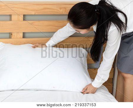Asian women maid working in bedroom in home