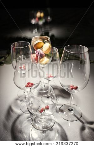 Crystal clear wine and cognac or brandy glasses. Reception concept