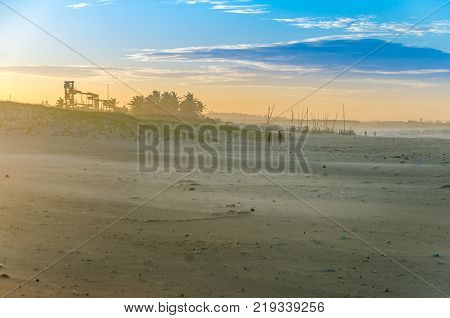 Buggy On The Beach At The Sunset