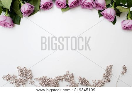 Spring wedding flowers decor. Pink roses with silver adornment on white background. Elegant and tender reception party flower arrangement