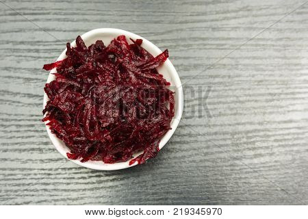 A bowl of boiled beets grated. View from above.