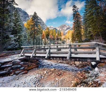 First snow on Braies Lake. Colorful autumn landscape in Italian Alps Naturpark Fanes Sennes Prags Dolomite Italy Europe.