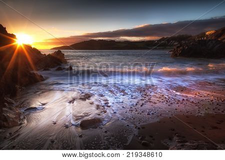 Sunset on the beautiful coastline of Rotherslade Bay, a small bay in South Gower next to the more famous Langland Bay.