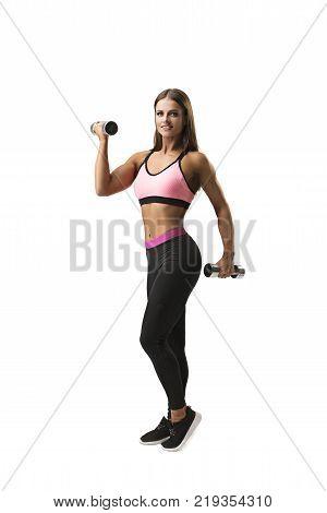 Sexy slim fitness model exercising with dumbells isolated full-length shot on white background