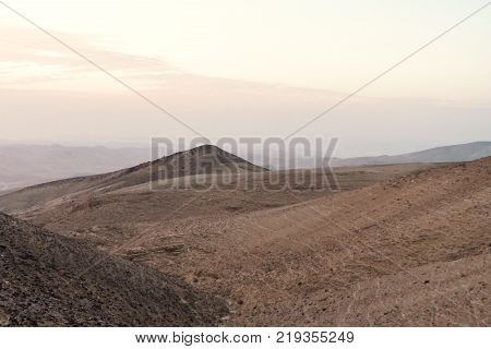 Sunrise in negev desert in Israel. Morning landscape of natural nature, sand and stones. Scenic land mountains and rocks in middle east. Nobody on photo