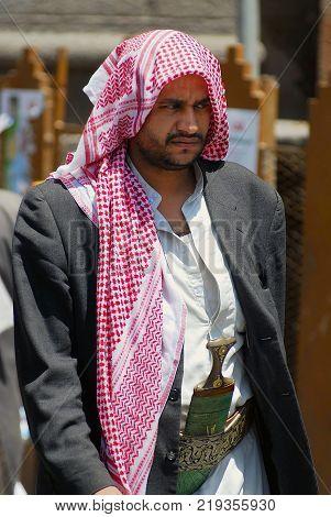 SANAA, YEMEN - SEPTEMBER 18, 2006: Unidentified Yemeni man wears janbiya dagger at a street in Sanaa, Yemen. Janbiya is a traditional dagger and a mandatory attribute of Yemeni men's suit.
