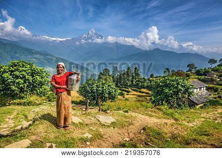 DHAMPUS, NEPAL - OCTOBER 27, 2015 : Nepalese woman in front of her home in the Himalayas mountains near Pokhara