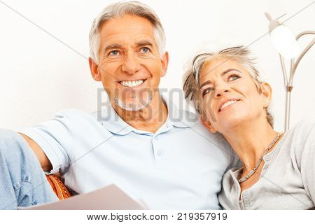 Happy senior couple is doing their paperwork
