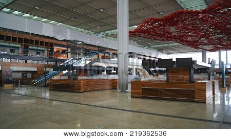 BERLIN, GERMANY - JAN 17th, 2015: Inside of the Berlin Brandenburg Airport BER, still under construction, empty terminal building, architecture tour.