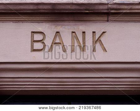 vintage Bank sighn carved in stone letters