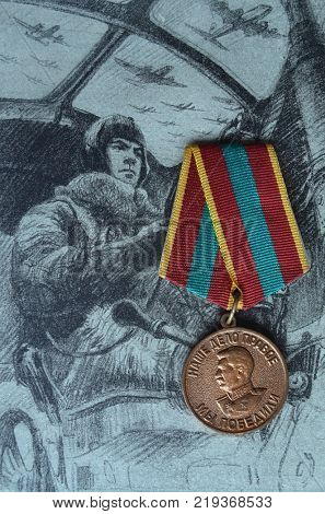 ILLUSTRATIVE EDITORIAL.Soviet  Army WWII medal.Background - Book  Sturm of Berlin circa 1946 illustration. Kiev,Ukraine December 22 ,2017