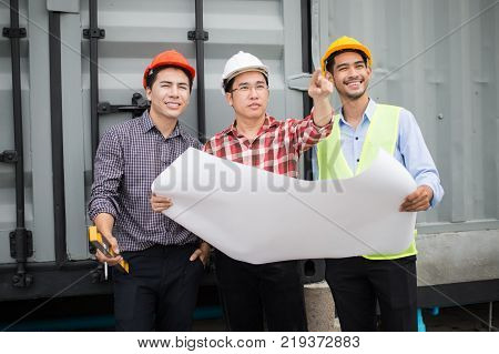 engineer and construction team wearing safety helmet and blueprint on hand. they are working on checking progress of construction site. engineer and client reviewing material and checking construction process in construction site area.