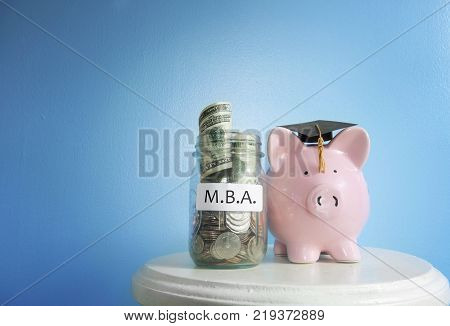 Piggy bank graduate with MBA (Masters of Business Administration) coin jar