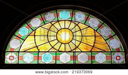 ROME, ITALY - SEPTEMBER 03: Holy Spirit Bird, stained glass in Basilica dei Santi Ambrogio e Carlo al Corso, Rome, Italy on September 03, 2016.