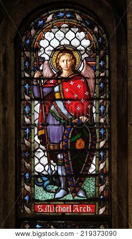 LUCCA, ITALY - JUNE 03: Saint Michael the Archangel, stained glass window in the San Michele in Foro church in Lucca, Tuscany, Italy on June 03, 2017.