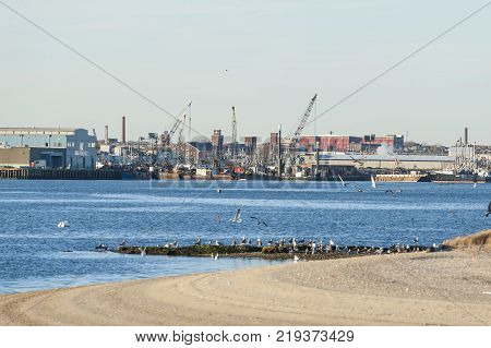 New Bedford Massachusetts USA - December 21 2017: New Bedford waterfront from hurricane barrier looking across Palmer's Island