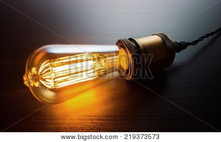 Retro Vintage Edison Bulb On A Table