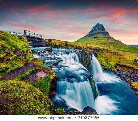 Summer sunset on famous Kirkjufellsfoss Waterfall and Kirkjufell mountain. Colorful evening scene on Snaefellsnes peninsula Iceland Europe. Artistic style post processed photo. poster