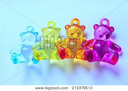 Newborns, Family, Childhood and Toys Concept.Toy Bears.Colored Toys Background with A Lot Of Copy-Space for Text.Image of a teddy bears.Toys Background. Little Colored Plastic Toys.