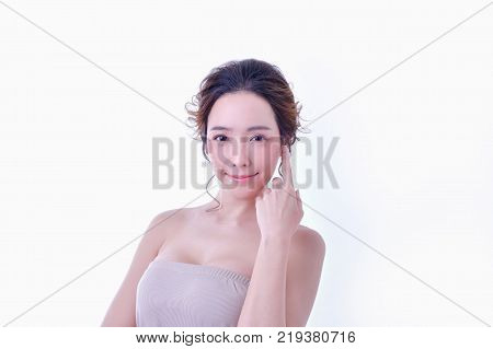 The concept of healthy beautiful woman. Beautiful women keep healthy. Beautiful women take care of skin health. Beautiful girl on white background