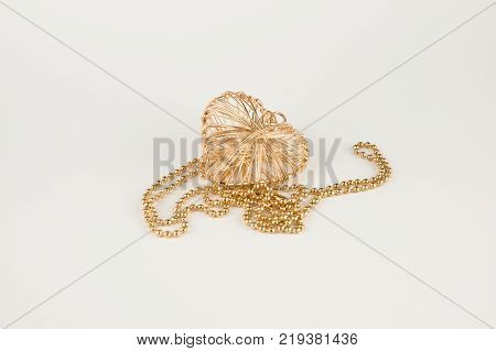 Decoration in the form of a heart made of wire isolated on white background