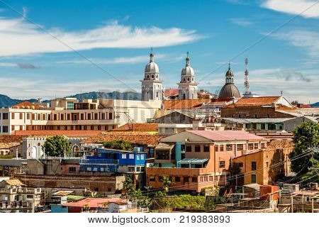 View to the city center with old houses and Basilica of Our Lady of the Assumption Santiago de Cuba Cuba