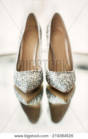 Wedding shoes on the lamp. Wedding preparation