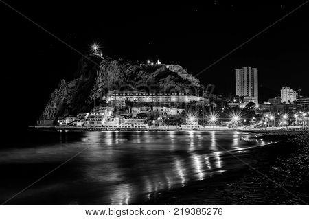 Night by the sea at Poniente Beach in Benidorm, Spain