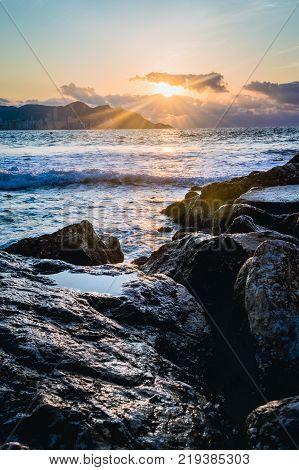 Spectacular sunrise captured at Mediterranean Sea on Poniente Beach in Benidorm, Spain.
